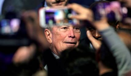 "Democratic presidential candidate and former New York City Mayor Michael Bloomberg poses for photographs with supporters during his campaign launch of ""Mike for Black America,"" at the Buffalo Soldiers National Museum, Thursday, Feb. 13, 2020, in Houston. (AP Photo/David J. Phillip)"